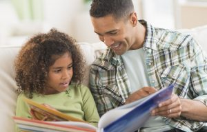 3 Ways Homeschooled Children Learn to Read Father reading picture book to child #5SLL #5sensesLL #normalisoverrated #homeschool #homeschoolkindergarten#neurodiversehomeschooling #adhdhomeschooling