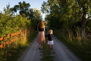 mom and child walking on path #5SLL #5sensesLL #normalisoverrated #homeschool #neurodiversehomeschooling #adhdhomeschooling #specialneedshomeschooling